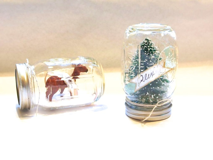 These darling DIY snow globe place cards are a super easy craft that makes such a statement for your holiday table.